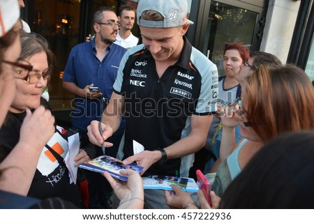 BUDAPEST, HUNGARY-  JULY 23: F1 driver Nico Hulkenberg is among his fans and giving autographs on July 23, 2016 in Budapest.