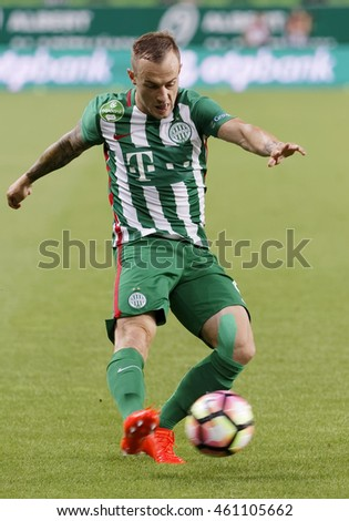 BUDAPEST, HUNGARY - JULY 30, 2016: Gergo Lovrencsics of Ferencvarosi TC crosses the ball during the Hungarian OTP Bank Liga match between Ferencvarosi TC and DVTK at Groupama Arena.
