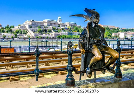 BUDAPEST, HUNGARY - 23 JULY 2013: Little Princess perched by the tram rails on the Pest, with Buda Castle in background, landmark of Hungary capital city. Budapest, Hungary.