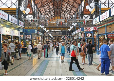 BUDAPEST, HUNGARY - JULY 13: Shoppers in Central Market Hall in Budapest on JULY 13, 2015. People Shopping in Great Market Hall in Budapest, Hungary. - stock photo
