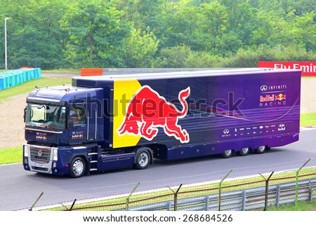 BUDAPEST, HUNGARY - JULY 27, 2014: Voilet semi-trailer truck Renault Magnum of the Infiniti Red Bull F1 racing team at the Hungaroring Formula One Race Track. - stock photo