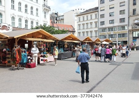BUDAPEST, HUNGARY - JUNE 22, 2014: People visit souvenirs market in Budapest. 3.3 million people live in Budapest Metropolitan Area. It is the largest city in Hungary and 9th largest in the EU. - stock photo