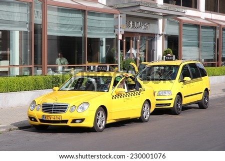 BUDAPEST, HUNGARY - JUNE 19, 2014: Taxi drivers wait in Budapest. There are some 5,300 taxi cabs in Budapest.