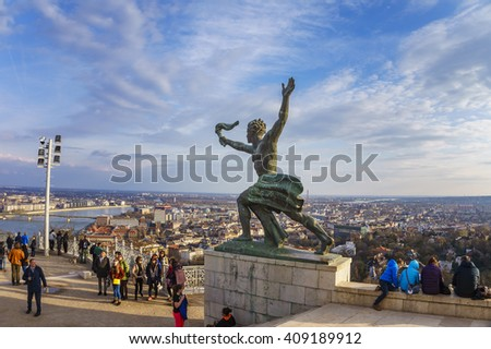 BUDAPEST - HUNGARY, 19 MARCH 2016: Cityscape and statue of torch bearer on Gellert Hill in Budapest, Hungary