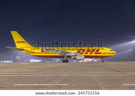 BUDAPEST, HUNGARY - MARCH 5 - DHL Airbus A300 cargo plane at Budapest Airport, March 5th 2014. DHL is a world market leader in air mail - stock photo