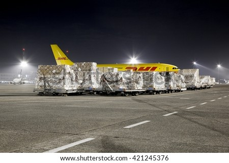 BUDAPEST, HUNGARY - MARCH 5, 2014: DHL Airbus A300 cargo plane at Budapest Airport with containers to be loaded. DHL is a world market leader in air mail - stock photo