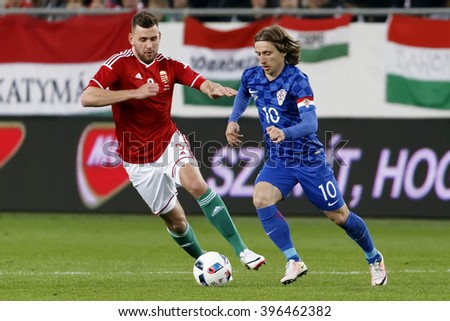 BUDAPEST, HUNGARY - MARCH 26, 2016: Hungarian Adam Szalai (l) tries to follow Croatian Luka Modric during Hungary vs. Croatia international friendly football match in Groupama Arena.