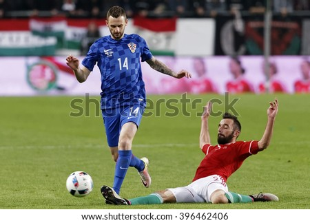 BUDAPEST, HUNGARY - MARCH 26, 2016: Hungarian Attila Fiola (r) tries to tackle Croatian Marcelo Brozovic during Hungary vs. Croatia international friendly football match in Groupama Arena.