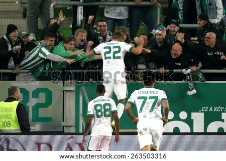 BUDAPEST, HUNGARY - MARCH 22, 2015: Supporters of Ferencvaros celebrate their team's second score during Ferencvaros vs. MTK OTP Bank League football match in Groupama Arena.