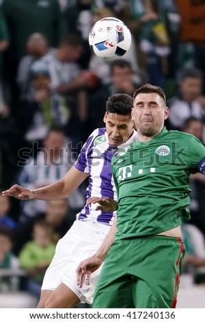 BUDAPEST, HUNGARY - MAY 7, 2016: Akos Kecskes (L) of Ujpest battles for the ball with Daniel Bode of Ferencvaros during the Hungarian Cup Final match between Ujpest and Ferencvaros at Groupama Arena - stock photo