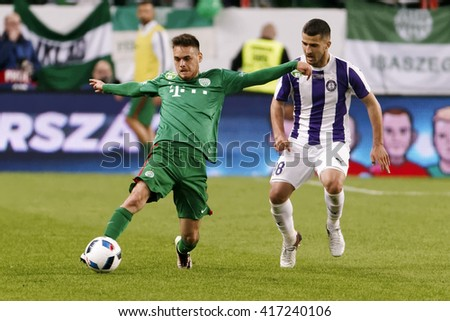 BUDAPEST, HUNGARY - MAY 7, 2016:  Bojan Sankovic (R) of Ujpest duels for the ball with Andras Rado of Ferencvaros during the Hungarian Cup Final match between Ujpest and Ferencvaros at Groupama Arena - stock photo