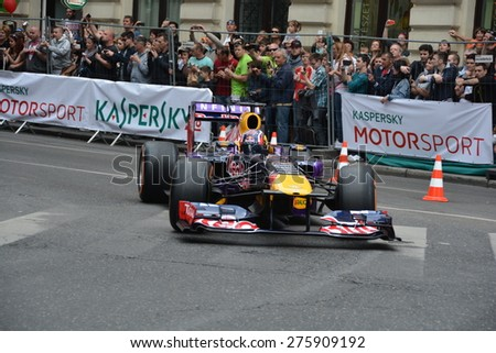 BUDAPEST, HUNGARY - MAY 1: F1 driver Danyiil Kvjat is driving on The Great Race Street Parade on May 1, 2015 in Budapest.  - stock photo