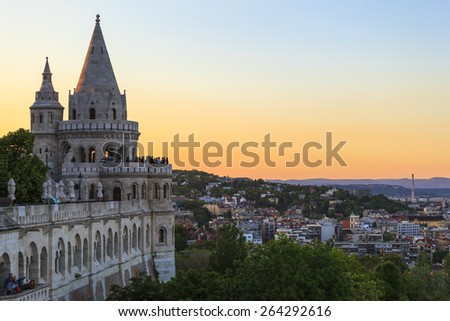 BUDAPEST, HUNGARY - MAY 9 2014:  Fishermen Bastion  in Budapest. Conical towers from Castle Hill, are an allusion to the tribal tents of the early Magyars. Budapest on the background.  - stock photo