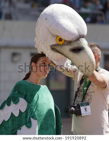 BUDAPEST, HUNGARY - MAY 10, 2014: Mascot eagle of Ferencvaros is dressed during Ferencvaros vs. Diosgyori VTK OTP Bank League football match at Puskas Stadium. - stock photo