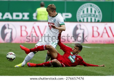 BUDAPEST, HUNGARY - MAY 10, 2015: Michal Nalepa of Ferencvaros (l) is tackled by Norbert Balogh of DVSC during Ferencvaros vs. DVSC OTP Bank League football match in Groupama Arena.  - stock photo
