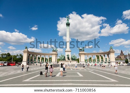 Budapest, Hungary - 2017, May 27 : The Millennium Monument in the Heroes Square next to the City Park of Budapest with tourists walking around and taking photographs, Hungary