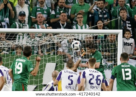 BUDAPEST, HUNGARY - MAY 7, 2016: Zoltan Gera (R up) of Ferencvarosi TC heads the winning goal during the Hungarian Cup Final football match between Ujpest FC and Ferencvarosi TC at Groupama Arena - stock photo