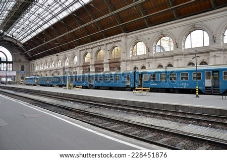 Budapest, Hungary - November 5, 2012: A regional commuter train operated by a diesel electric locomotive at a platform at Budapest Gare which is the main international  railway terminal in Budapest.  - stock photo