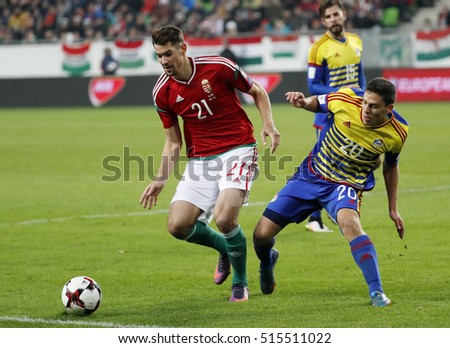 BUDAPEST, HUNGARY - NOVEMBER 13, 2016: Barnabas Bese #21 of Hungary competes for the ball with Max Llovera #20 of Andorra during the Hungary v Andorra FIFA WC Qualifier at Groupama Arena.