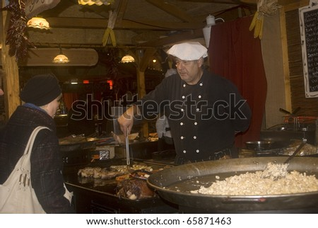 BUDAPEST, HUNGARY - NOVEMBER 24: Cook offers his delicious food in the Christmas Market at November 24, 2010 in Budapest, Hungary. The Budapest Christmas Market is the biggest in Eastern Europe.