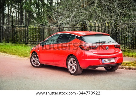 BUDAPEST, HUNGARY - NOVEMBER 27, 2015: 2016 model year Opel Astra (generation K) red 5-door hatchback at the test-drive.