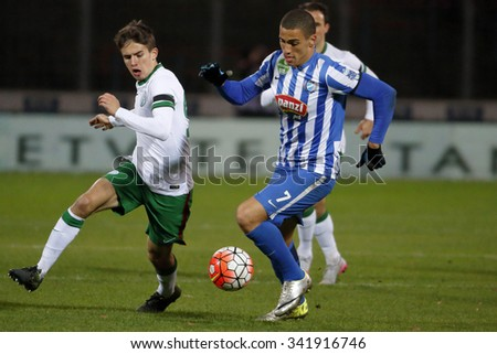 BUDAPEST, HUNGARY - NOVEMBER 21, 2015: Myke Bouard Ramos of MTK (r) is watched by Adam Nagy of Ferencvaros during MTK Budapest - Ferencvaros OTP Bank League football match at Illovszky Stadium.  - stock photo
