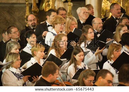 BUDAPEST, HUNGARY - NOVEMBER 20: The Budapest Youth Choir performs at the Szent Teraz Templom on Nov 20, 2010 in Budapest, Hungary - stock photo