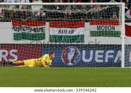 BUDAPEST, HUNGARY - NOVEMBER 15, 2015:The first Hungarian goal is watched by Norwegian goalkeeper Orjan Nyland during Hungary vs. Norway UEFA Euro 2016 qualifier play-off match at Groupama Arena. - stock photo