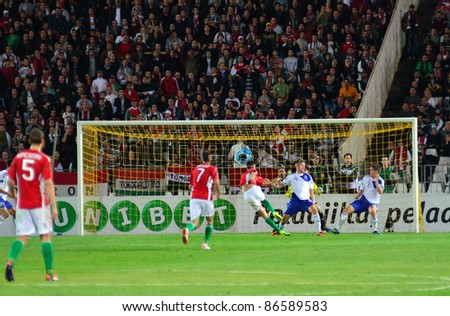 BUDAPEST, HUNGARY - OCTOBER 11 : Hungarian international Tamas Priskin shoots the ball at Hungary - Finland European Cup qualifier football match at October 11, 2011 in Budapest, Hungary. - stock photo