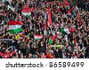 BUDAPEST, HUNGARY - OCTOBER 11 : Hungarian supporters with national flags at Hungary - Finland European Cup qualifier football match at October 11, 2011 in Budapest, Hungary. - stock photo