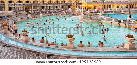 BUDAPEST, HUNGARY - OCTOBER 12: Szechenyi thermal bath on October 12, 2009 in Budapest, Hungary. The Szechenyi bath was built in 1913 and is the largest medicinal bath in Europe. - stock photo