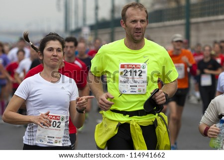 BUDAPEST, HUNGARY - OCTOBER 7: unidentified marathon runners at SPAR Budapest International Marathon on October 7, 2012 in Budapest, Hungary - stock photo