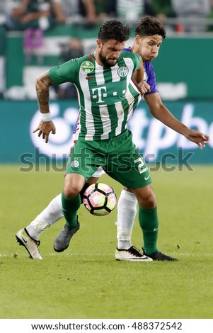 BUDAPEST, HUNGARY - SEPTEMBER 24, 2016: Akos Kecskes (R) of Ujpest FC fouls Marco Djuricin (L) of Ferencvarosi TC during Ferencvaros v Ujpest FC OTP Bank Liga match at Groupama Arena
