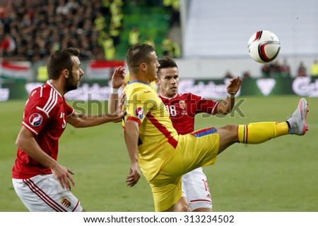 BUDAPEST, HUNGARY - SEPTEMBER 4, 2015: Between Hungarian Fiola (l) and Stieber (18) kicks the ball Romanian Torje during Hungary vs. Romania UEFA Euro 2016 qualifier football match in Groupama Arena. - stock photo