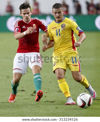 BUDAPEST, HUNGARY - SEPTEMBER 4, 2015: Duel between Hungarian Zoltan Stieber (l) and Romanian Gabriel Torje during Hungary vs. Romania UEFA Euro 2016 qualifier football match in Groupama Arena. - stock photo