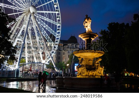 Budapest, Hungary, September 13 2014: Ferris wheel and monument at night in Budapest, Hungary - stock photo