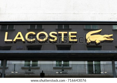 Budapest, Hungary, September 13, 2017: Lacoste sign on a store. Lacoste is a French clothing company that sells high-end clothing, footwear, perfume, leather goods, and most famously polo shirts