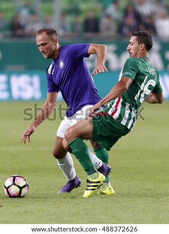 BUDAPEST, HUNGARY - SEPTEMBER 24, 2016: Leandro De Almeida aka Leo #16 of Ferencvarosi TC tackles Janos Lazok (L) of Ujpest FC during Ferencvaros v Ujpest FC OTP Bank Liga match at Groupama Arena