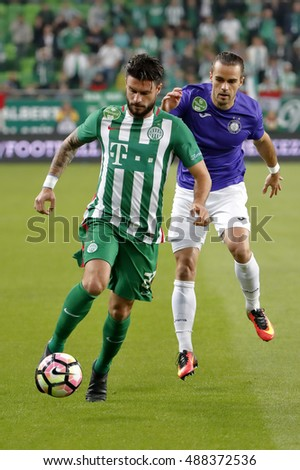 BUDAPEST, HUNGARY - SEPTEMBER 24, 2016: Marco Djuricin (L) of Ferencvarosi TC covers the ball from David Mohl (R) of Ujpest FC during Ferencvaros v Ujpest FC OTP Bank Liga match at Groupama Arena