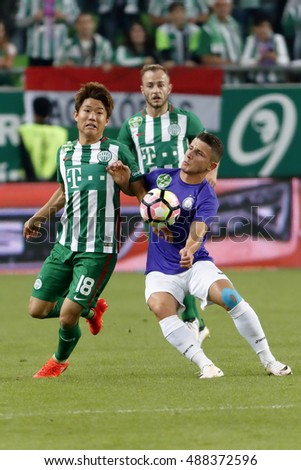 BUDAPEST, HUNGARY - SEPTEMBER 24, 2016: Seung-Woo Ryu #18 of Ferencvarosi TC duels for the ball with Enis Bardhi (R) of Ujpest FC during Ferencvaros v Ujpest FC OTP Bank Liga match at Groupama Arena