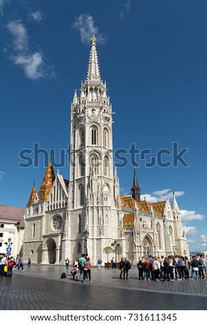 BUDAPEST, HUNGARY - SEPTEMBER 13, 2017: Tourists surround Matthias Church which is a Roman Catholic church at he heart of Buda's Castle district in Budapest, Hungary