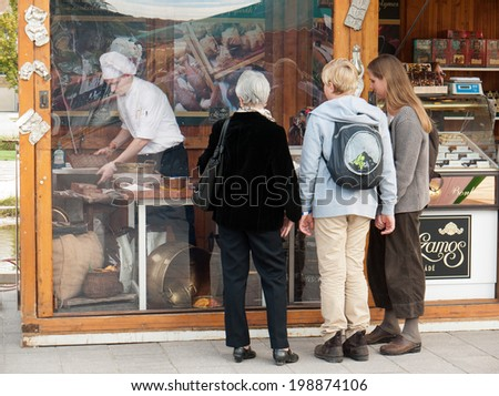 BUDAPEST, HUNGARY - SEPTEMBER 20, 2013: Visitors watch a professional chocolatier at the Sweet Days Chocolate and Candy Festival. - stock photo