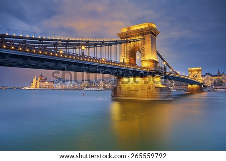 Budapest. Image of Budapest, capital city of Hungary, during twilight blue hour, with Chain Bridge in the foreground and Hungarian parliament in the background. - stock photo
