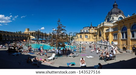 BUDAPEST - JULY 10: People have a thermal bath in the Szechenyi spa on July 10, 2012 in Budapest. Szechenyi Medicinal Bath is the largest medicinal bath in Europe. - stock photo