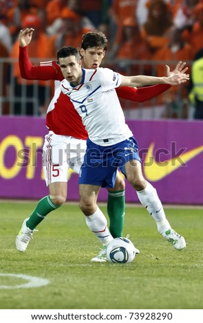 BUDAPEST - MARCH 25: Dutch Robin van Persie (9) and Hungarian Laczko (5) during Hungary vs. Netherlands UEFA Euro 2012 qualifying game at Puskas Ferenc Stadium on March 25, 2011 in Budapest, Hungary.