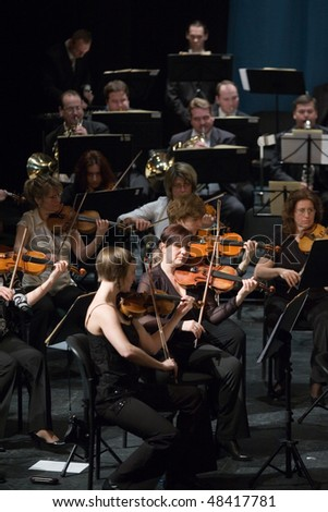 BUDAPEST - MARCH 06: Members of the MAV  Symphonic Orchestra perform on stage at Thalia Theater on March 06, 2010 in Budapest, Hungary. - stock photo