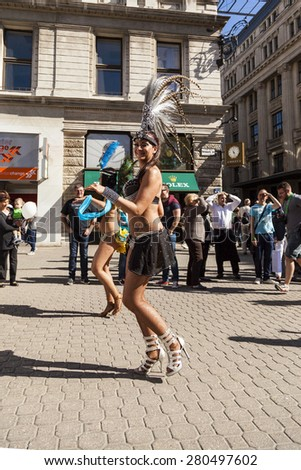 BUDAPEST - MAY 10: Spring Festival Parade where different people celebrated the warm weather arrival in a Rio Style Parade-while onlookers cheered along 2014 on May 10, 2014 in Hungary.  - stock photo