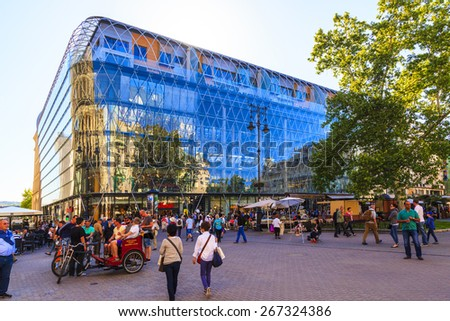 BUDAPEST MAY 11 2014: The newly renovated inner city in Budapest is a big attraction for tourists all over the world. Budapest's beauty shown through many centuries of architecture, Hungary.  - stock photo