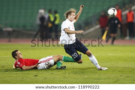 BUDAPEST - NOVEMBER 14: Hungarian Roland Juhasz (L) and Norse Alexander Toft Soderlund during Hungary vs. Norway  friendly football game at Puskas Stadium on November 14, 2012 in Budapest, Hungary. - stock photo