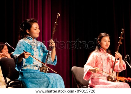 "BUDAPEST - NOVEMBER 13: Members of the Nanjing Chinese Traditional Orchestra perform on concert at ""Urania"" Budapest Nov 13, 2011 in Budapest, Hungary. - stock photo"